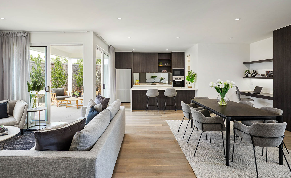 Spacious open plan living, dining, kitchen and terrace at The Breeze